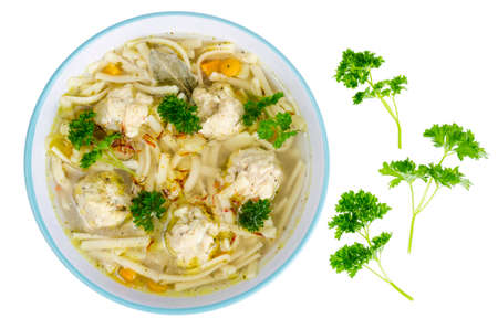 Chicken broth with egg noodles and meatballs. Studio Photo Stockfoto