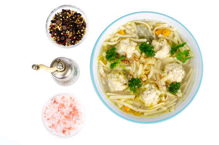 Chicken broth with egg noodles and meatballs. Studio Photo Stock Photo