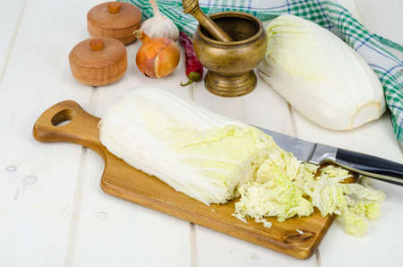 Sliced peking cabbage, spices for cooking vegetable diet dishes. Studio Photo