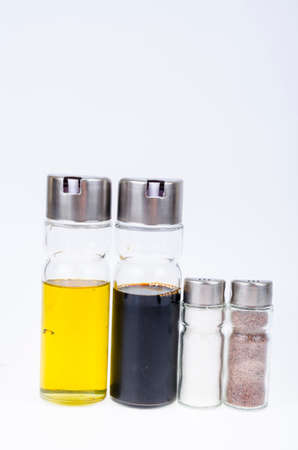 Set of glass bottles with olive oil, vinegar, salt and pepper for table setting. Studio Photo
