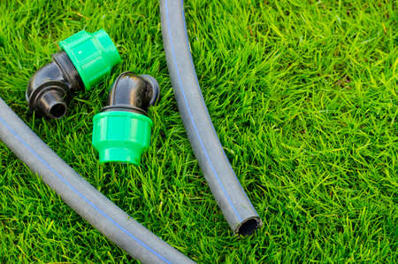 Plastic and hose for automatic watering the garden. Studio Photo