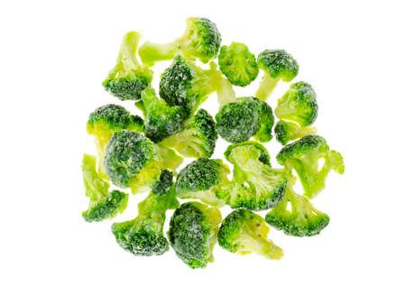 Preservation of vegetables, frozen broccoli cabbage on white background. Studio Photo