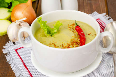 Spicy vegetarian vegetable puree soup green color, healthy eating.