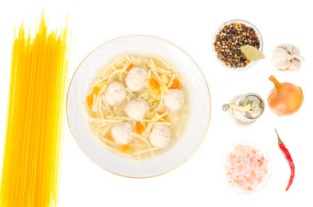 Broth with noodles and meat balls. Studio Photo