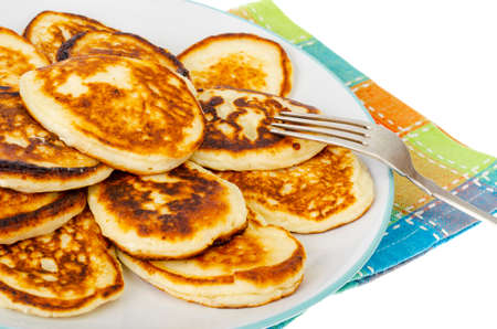 Fried homemade pancakes on plate, colored napkin. Studio Photo Stock fotó