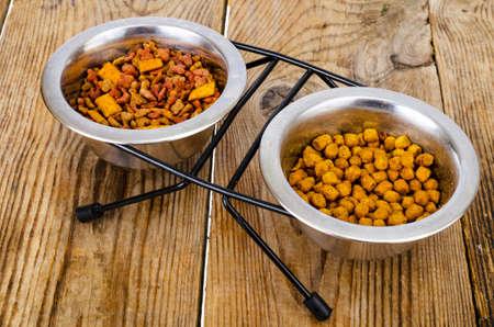 Granular pet food on brown wood background. Studio Photo