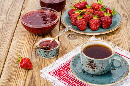 Ripe red sweet strawberry jam, fresh berries on wooden table. Studio Photo Archivio Fotografico