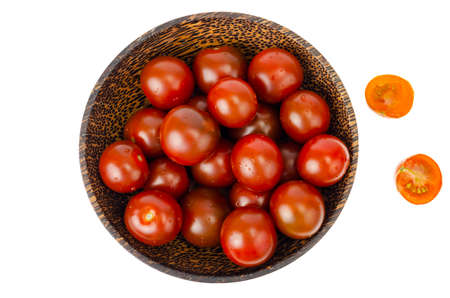 Small red and black cherry tomatoes isolated. Studio Photo Reklamní fotografie