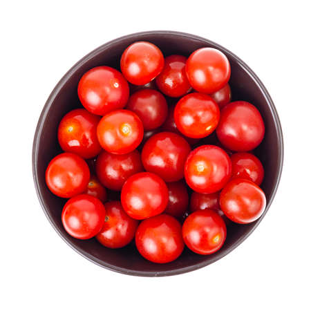 Vegetables. Small red cherry tomatoes isolated on white. Studio Photo Reklamní fotografie