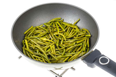 Frying pan with fried garlic arrows. Studio Photo Archivio Fotografico