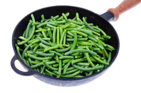 Green fresh green beans in frying pan. Studio Photo Stock fotó
