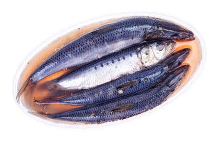 Pickled salted fish, herring in plastic. Studio Photo