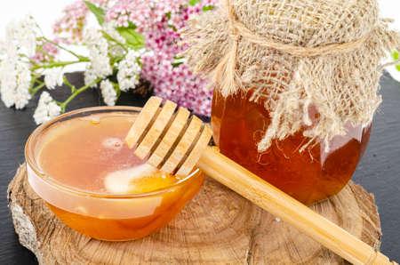Fresh honey from wild flowers and herbs. Studio Photo Фото со стока