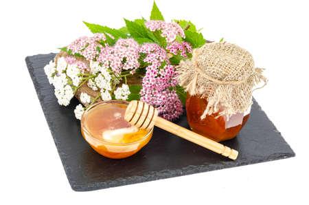 Fresh honey from wild flowers and herbs. Studio Photo Archivio Fotografico