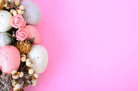Easter wreath of colorful decorative eggs, flowers. Studio Photo