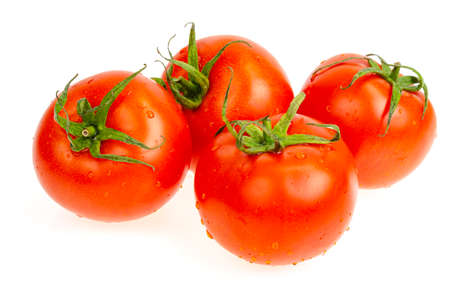 Four red wet tomatoes isolated on white background. Studio Photo