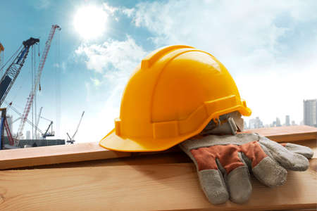 construction project: Helmet placed on the tool after work Stock Photo