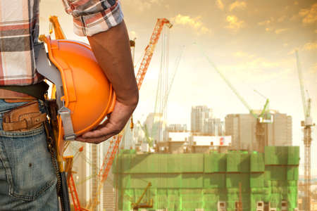 Construction worker checking location work site