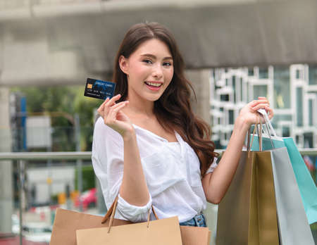 Young women use credit cards to spend