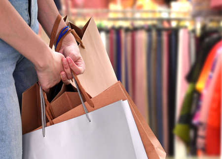 Women are happy to spend shopping in the mall Фото со стока