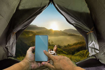 Tourists wake up to watch the sun rise In the midst of nature On a beautiful hill,Nature tourism season, hiking, sleeping in a tent Living independently