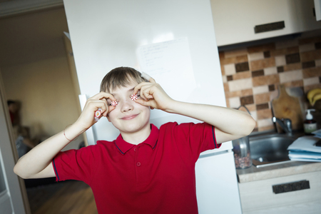 funny boy close eyes with candy like glasses.