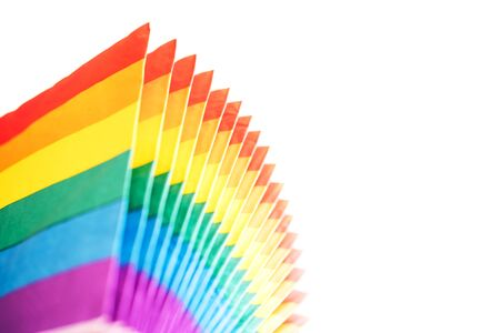 Fan-shaped rainbow napkins on a white background. LGBT concept Stock Photo