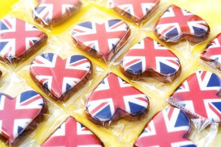 Several heart-shaped gingerbread cookies with the image of the flag of Great Britain