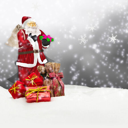 santa claus - merry christmas - santa claus with sack in snow - grey Stock Photo