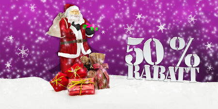 weihnachtsmann: santa claus - merry christmas 50 percent discount winter snow pink Stock Photo