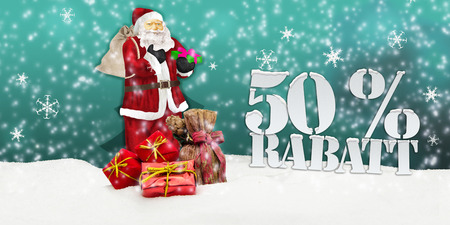 weihnachtsmann: santa claus - merry christmas 50 percent discount winter snow turquoise Stock Photo