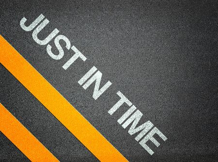 just in time: Just in time Text Writing Road Asphalt Word Floor Ground Stock Photo