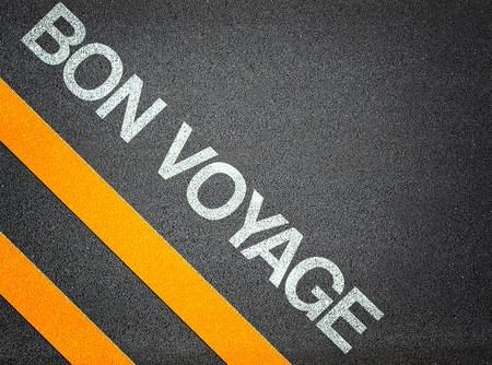 bon: Bon Voyage Text Writing Asphalt Road Floor
