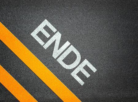ende: German Ende End Text Writing Road Asphalt Word Floor Ground Stock Photo
