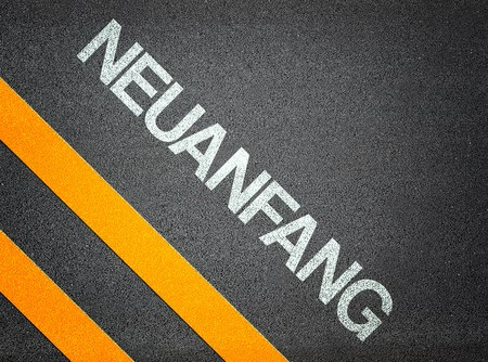 frisse start: German Neuanfang - nieuwe start - Tekst Schrijven Road Asphalt Word Floor Ground