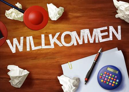 willkommen: willkommen desktop memo calculator office think organize Stock Photo