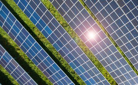 sun energy: Power plant using renewable solar energy with sun meadow Stock Photo