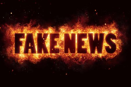 defuse: Fake news fire text flame flames burn burning hot explosion Stock Photo