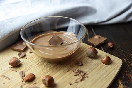 Cracked chocolate pile on dark background with shallow depth of field Standard-Bild