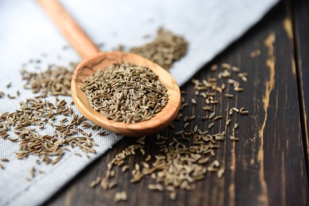 pile of caraway on wooden table Stock Photo