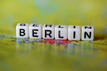 Word BERLIN formed by alphabet blocks on atlas map Stock Photo