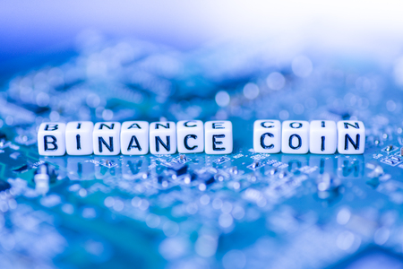 Word BINANCE COIN formed by alphabet blocks on mother cryptocurrency