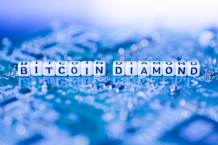 Word BITCOIN DIAMOND formed by alphabet blocks on mother cryptocurrency Stock Photo