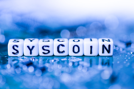 Word SYSCOIN formed by alphabet blocks on mother cryptocurrency Stock Photo