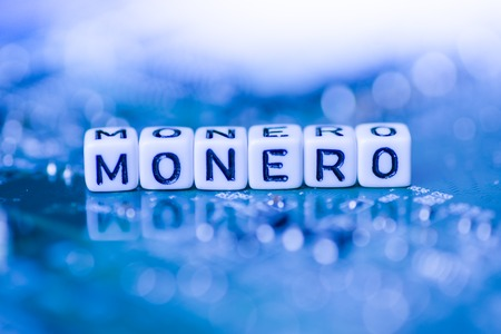 Word MONERO formed by alphabet blocks on mother cryptocurrency