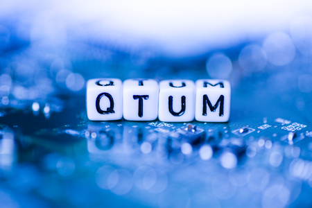 Word QTUM formed by alphabet blocks on mother cryptocurrency