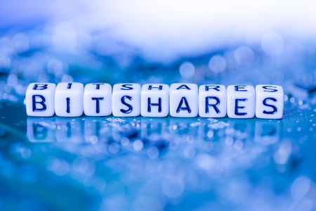 Word BITSHARES formed by alphabet blocks on mother cryptocurrency Stock Photo