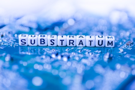 Word SUBSTRATUM formed by alphabet blocks on mother cryptocurrency Stock Photo