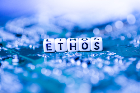 Word ETHOS formed by alphabet blocks on mother cryptocurrency