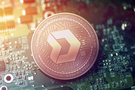 shiny copper DMARKET cryptocurrency coin on blurry motherboard background